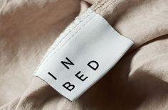 Logo and label for linen online retailer In Bed designed by Moffitt.Moffitt