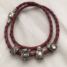 Pandora Rope bracelet with four charms Red Pandora rope bracelet with four silver charms - mermaid, penguin, & two decretive ones. Small tear in rope - still wears well Pandora Jewelry Bracelets
