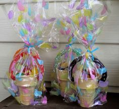 Easter basket made from ice cream cone filled with jelly beans......a twizler handle pushed into two holes on either side of the cone and wrapped in a cute favor bag! ~ce~ for AJ's 2nd grade class