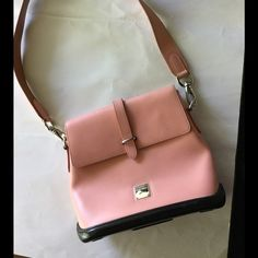 Dooney Bourke Parasol Flap bag  Stunning bag from the Dooney Bourke parasol collection. Super cute Nude pink color. Great condition. Minor pen as seen on the inside. Price is negotiable. Dooney & Bourke Bags Shoulder Bags