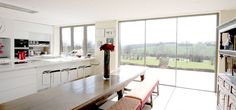 slim framed sliding patio doors make the most of fantastic views over the Cotswolds