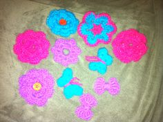 I crocheted a bunch of different things. Flowers, african flowers, butterflies, and bows. These are great for making hair accessories, or broaches for hats or tops :) Could also make a creative looking wreath with them :) we shall see :) African Flowers, How To Make Hair, Butterflies, Crochet Necklace, Hair Accessories, Bows, Creative, Crafts, Crochet Collar