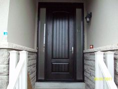 Entry Executive 8-Foot-FiberglasSigle-Solid-Rustic-Door-with-2-frosted-Side-Lights-Installed-in-Newmarket-Ontario by Fiberglass Doors