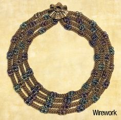 Vivid niobium and brass rings are linked with Full Persian chain mail into a draped, multistrand collar necklace. Change the metals or colors to create dramatically different looks. By Spider