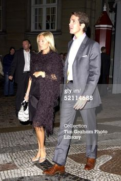 COPENHAGEN, DENMARK - MAY 1, 2004: Crown Prince Pavlos Of Greece And His Wife Princess Marie-chantal Leave The Palace After Dinner To Attend A Party In A Club.