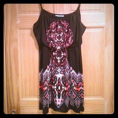 Cute dress Wore a few times. Excellent condition. Black red white and tan colors. Super cute Dresses