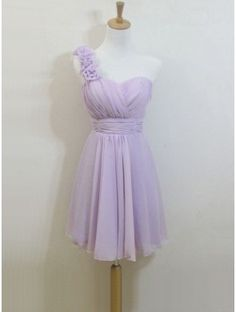Knee length lilac bridesmaid dress but with white flowers on the shoulder