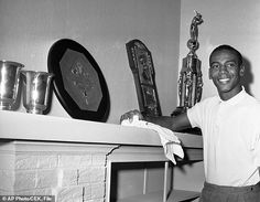 Winner: Above, banks poses in November 1959 with an MVP award from the National League