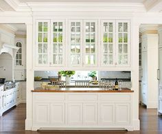 Multipurpose Buffet A buffet filled with glass door cabinets allows light to pass from the kitchen to the dining area. This design choice capitalizes on the ...