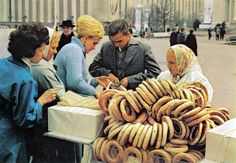 National Geographic visits the USSR | Merchant selling giant bagels.