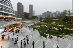 plaza of the Galaxy SoHo designed by Zaha Hadid Architects and EcoLand Design Group in Beijing Landscape Plaza, Landscape Stairs, Urban Landscape, Villa Architecture, Landscape Architecture Design, Architecture Graphics, Architectes Zaha Hadid, Zaha Hadid Architects, Design Plaza