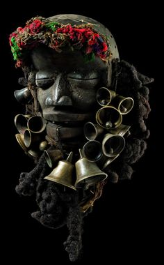 Africa | Singer's mask from the W� people of the Ivory Coast | Wood, woolen threads, human hair for the beard, brass bells, teeth and horn. http://streetshamans.com