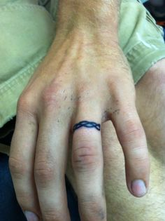 Cord of three strands wedding band tattoo