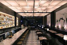 Bar design. Lantern street grid ceiling.  Horse pictures.