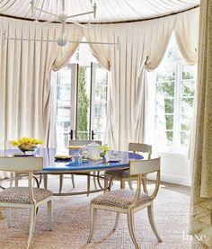 A plaster chandelier from Bourgeois Bohème and the custom lava stone-topped table from Sue Fisher King add modern touches to this otherwise traditional dining room.