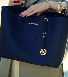 """""""...with my purchase of a fabulous bags that I now carry around proudly.""""  #michaelkors #handbags #bags"""