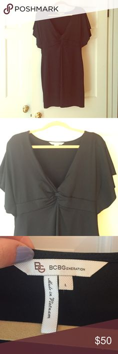LBD Black dress from BCBG. Fitted. Low V-neck with a twist at the bottom. Barely worn. BCBGeneration Dresses Midi