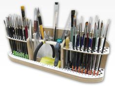 With the Brushes and Tools Holder you can safely store all kinds of modeling tools like brushes, drill bits, files, pincers, pipettes etc. It has holes of different diameters, which allows storage of various sized tools, and a convenient carrying handle. The Brushes and Tools Holder can be wall-hung if required. Thanks to this handy unit tools are always at your fingertips.