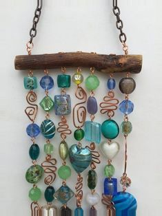 This glass beaded wind chime and sun catcher is the perfect way to brighten your. - This glass beaded wind chime and sun catcher is the perfect way to brighten your patio, yard, a kitc - Carillons Diy, Mesquite Wood, Diy Wind Chimes, Glass Wind Chimes, Wire Crafts, Beaded Crafts, Garden Crafts, Wire Art, Beads And Wire