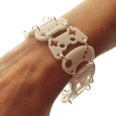 The Controller Bracelet is made out of laser-cut acrylic and chained together with silver rings.. This is so cool! It comes in other colors too