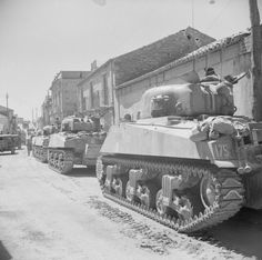 One squadron of Calgary tanks landed on D-Day Italy with the Canadian 1st Division, with the remainder following up in reserve landings. But the tanks had been unable to negotiate the highlands and had hardly advanced past Reggio. In this photo, an A Squadron Sherman of the Calgary Regiment awaits movement orders. (Photo: Sgt Loughlin, No.2 SFPU, ©IWM NA 6490)