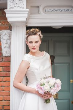 Sassi Holford English Rose styled shoot by Miss Bush, featuring Emma, a crisp contemporary wedding dress with high low hem, structured skirt and jacket