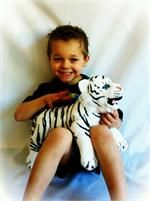 Weighted Stuffed animals. Never considered this, but I think Lil would respond more to this than the blanket.