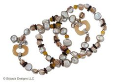 "Great style has no gray area with three Pearl, Quartzite, Shell, Glass and Sterling Silver Stretch Bracelets. Fits up to a 7"" wrist."