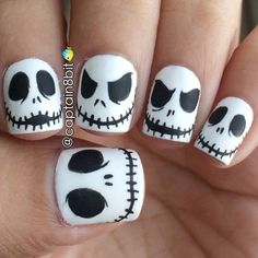i did a cool design on my cinderella hand (previous post) because i was going to do an EVEN COOLER design on my not-cinderella hand? lol. the jack skellington nails are back!!  & i love them more this year than last year's. the matte top coat really makes them even more awesome. ugh, i'm so proud of these!  i love the friggin' shizznit out of the nightmare before christmas, if you couldn't already tell, hahah.