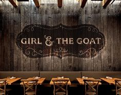 Girl & the Goat by GRIP. Really elegant and traditional branding. What you see a lot now is the traditional branding set within a modern atmosphere. Traditional serif fonts with a wooden texture jump off the darker back plaque shape in which its contained.