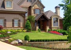 40 Front Yard Landscaping Ideas For A Good Impression the small hedge with taller on ends