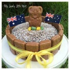 This Australia Day cake is super easy to create, only takes ten minutes to decorate and uses a delicious store bought cake from Woolworths. When I think about iconic Australian sweets, you can't go past lamingtons, Tim Tams and the… Continue Reading → Australian Sweets, Australian Party, Australian Recipes, Aussie Christmas, Australian Christmas Food, Christmas Decorations Australian, Christmas Crack, Christmas Punch, Vegan Christmas
