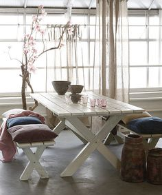 Indoor picnic table...must have in my remodeled kitchen!!! I think it a fun way to med modern and country!! Plus with a family of five it helps keep thing symmetrical.