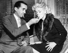 Marilyn Monroe with television journalist Edward R. Murrow, 1955