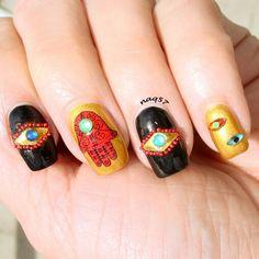 Hamsa nail art design.
