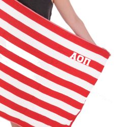 Alpha Omicron Pi Towel in red with white stitched letters. Shop the #AlphaOmicronPi collection at M&D Sorority Gifts. 300+ items. #aopii