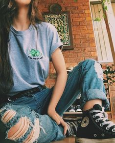 Graphic tee + ripped jeans + black sneakers