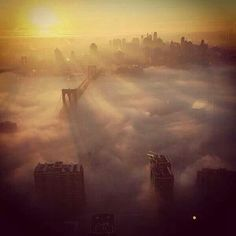NYC Brooklyn Bridge covered by fog.