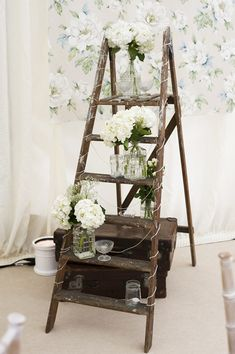 lovely idea - vintage ladder as flower stand