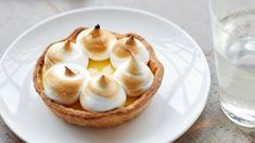 Easy press-in crusts are filled with a citrusy custard filling in these mini desserts. Gilded with gorgeous piped swirls of meringue, they're guaranteed to be a hit. Lemon Custard Tart, Custard Filling, Lemon Tarts, Lemon Curd, Flan, Ricotta, Individual Appetizers, Dessert Crepes, Potato Bites