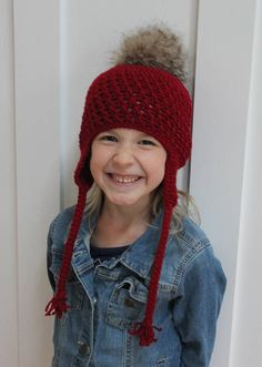 This little girl hat is made using deep red yarn and features a fur pom pom. This little hat is the perfect accessory for your little one!  All items come from a smoke free and pet free home.  Thank you!  Stop by and say hi on Instagram @HatsByJoBeth  ***Sizing*** Newborn- fits a head circumference up to 14 inches 3-6 months- fits a head circumference of14-16 inches 6-12 months- fits a head circumference of 16-18inches 12-24 months- fits a head circumference of 18-19.5 inches 2-5 years- fits…