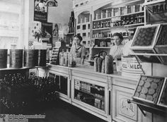 A well-ordered grocery store, 1913. By the early twentieth century, Germany was a highly industrialized country. A consumer society also developed. The shop in this photograph catered to the needs of German consumers. It offered whole milk, cocoa and chocolate, baked goods such as bread, packaged egg noodles, and bottled beverages.