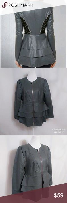 Lace Up Faux Leather Jacket Lace up faux leather jacket size - XL (16) in dark grey. Lattice lace up borders the sides of this jacket forba tough girl look while three layers of ruffles at front and back sweeten it up! Front zip closure, silvertone hardware and fully lined. Viscose and poly lining. Edgy and feminine! VENUS Jackets & Coats