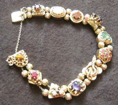 Vintage 14k Slide Bracelet 11 Fantastic Charms Including Snake W/Diamond
