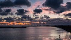 Sunset colors and clouds in the sky by Bram van Broekhoven