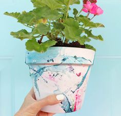 DIY marbled flower pot |Gina Michele Make this pot with only nailpolish and water!