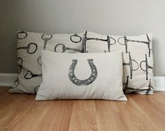 Equestrian Pillow Covers Set of Three- handprinted horse shoe and snaffle bits via Etsy