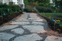 We modified the existing walkway, which was only a single slab wide.  Pea gravel was used in the joints, and the walkway was lit with path lights from Focus Industries.  Delaware County, PA