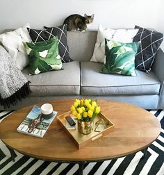 Add a square lacquer tray to your coffee table arrangement for a bit of glamour and to keep things organized.