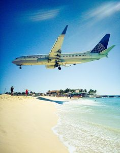 Maho Beach and Sunset Beach Bar, St. Maarten. I think everyone should visit here! Where else can you be this close to a plane landing? Such an amazing experience